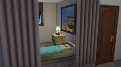 Toddler room also separated from the main living area by curtains. An additional single bed fits under the window.