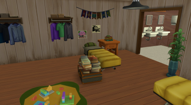 The upper floor has four beds, the campers' personal items, and additional activities. This cabin includes a building table. The open doorway to the right leads to the bathroom.