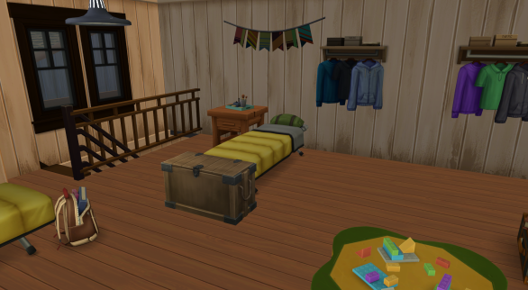 Another camper's bed with a footlocker.