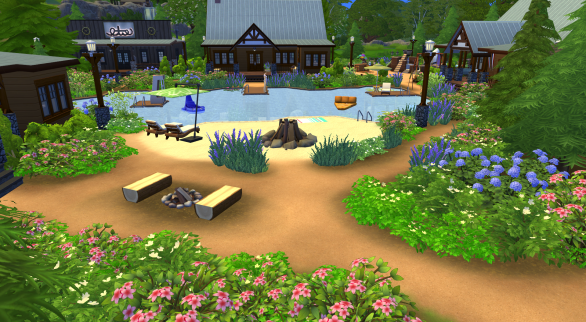 The lake with campfire, beach with bonfire, lounge chairs, and towel.