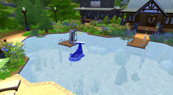 In the lake is a dock with a diving board. There are also floats in the lake.